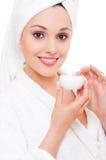 Woman with face cream Stock Photos