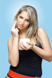 Woman with face cream. Beautiful blond woman applying face cream Royalty Free Stock Photos