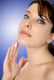 Woman with face cream Royalty Free Stock Image