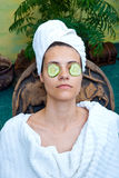 Woman face with cucumber mask Stock Photo