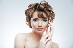 Woman face with curly  hair Royalty Free Stock Photos