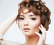 Woman face with curly  hair Stock Image