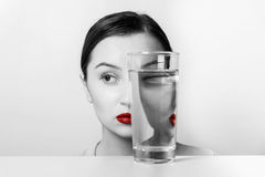Woman Face Distortion In Water Glass. Woman Face Distortion In Glass Of Water Royalty Free Stock Photography