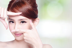 Woman face and eye care. And she making frame with hands, asian beauty Royalty Free Stock Photos