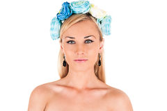 Woman face with floral blue rim on the head Royalty Free Stock Photography