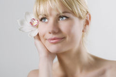 Woman face with flower Royalty Free Stock Images