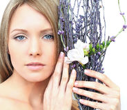 Woman face with flower - spring beauty Stock Photo