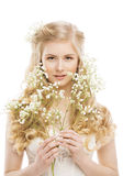 Woman Face and Flowers over White, Girl Makeup Portrait Royalty Free Stock Photos
