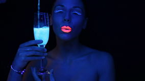 Woman face with fluorescent make up stock video
