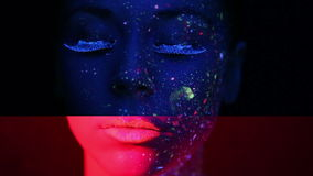 Woman face with fluorescent make up stock video footage