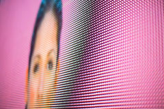 Woman face formed on pink colored LED smd screen Stock Photography