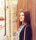 Woman  face glamour outdoor wooden door Stock Photos
