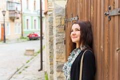 Woman  face glamour outdoor wooden door Stock Photo