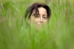 Woman face in grass Stock Photo