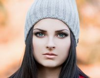 Woman face gray hat, blue contact lenses! royalty free stock photo