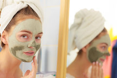 Woman face with green clay mud mask Royalty Free Stock Photos