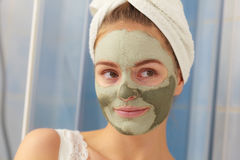 Woman face with green clay mud mask Royalty Free Stock Photo
