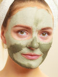 Woman face with green clay mud mask Stock Photo