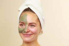 Woman face with green clay mud mask Royalty Free Stock Images