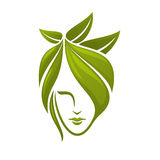 Woman face with green leaves Stock Photography