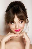 Woman face with hair motion pink lipstick, smile Royalty Free Stock Photography