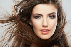 Woman face with hair motion on white background. Isolated close up portrait Stock Images