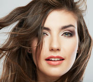 Woman face with hair motion on white background Royalty Free Stock Image