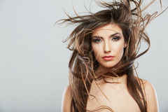 Woman face with hair motion on white background Stock Photo