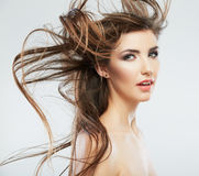 Woman face with hair motion on white background isolated Stock Images