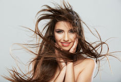 Woman face with hair motion on white background isolated Royalty Free Stock Photos