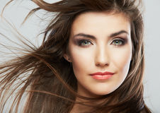 Woman face with hair motion on white background is Royalty Free Stock Image
