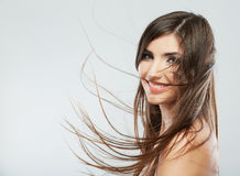 Woman face with hair motion on white background is Stock Photo