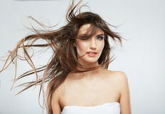 Woman face with hair motion on white background Stock Photos