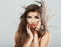 Woman face with hair motion on white background Royalty Free Stock Photos