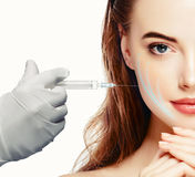 Woman face and hand in glove with syringe making injection Royalty Free Stock Photography