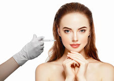 Woman face and hand in glove with syringe making injection Stock Image