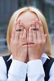 Woman with face on her hands Stock Images