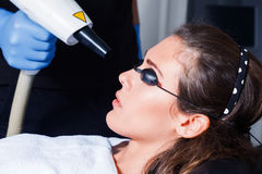 Woman face laser treatment Royalty Free Stock Images