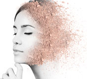 Woman face made from crumbly powder. Stock Images