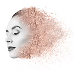 Woman face made from crumbly powder. Stock Image