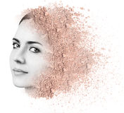 Woman face made from crumbly powder. Royalty Free Stock Images