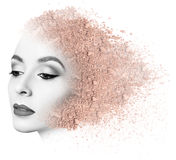 Woman face made from crumbly powder. Royalty Free Stock Photo