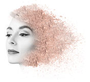 Woman face made from crumbly powder. Royalty Free Stock Photos