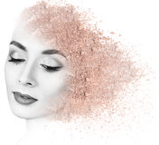 Woman face made from crumbly powder. Royalty Free Stock Photography