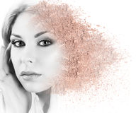 Woman face made from crumbly powder. Stock Photography