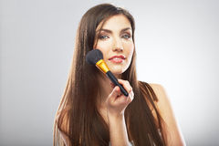 Woman face. Make up brush. Model long hair. Royalty Free Stock Photo