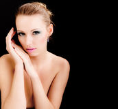 Woman face with makeup. beauty fashion model. Glamour portrait of beauty fashion female model, topless young girl on black background with empty space for text Royalty Free Stock Photos
