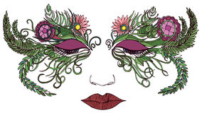 Woman face in a mask of colorful flowers Royalty Free Stock Photography