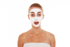 Woman in face mask with surprised expression Royalty Free Stock Photography
