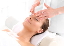 Woman at face massage Stock Photography